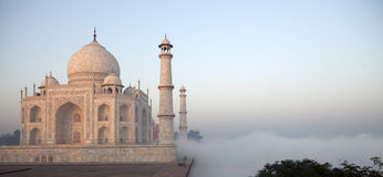 Clouds reach the Taj Mahal in India. Clouds from the Yamuna river, behind the famous Taj Mahal in India (Uttar Pradesh, India) flow over the terraces of the Taj Royalty Free Stock Photo
