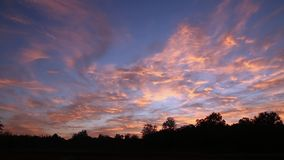 Clouds  red on blue sky with sunrise light stock video