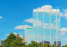 Clouds reflaction on office building windows Royalty Free Stock Photography