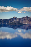 Clouds reflect in clear blue water at Crater Lake Royalty Free Stock Image