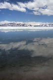 Clouds are reflected in the ice-free water of Sacred Lake Rakshastal. Royalty Free Stock Photos