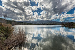 Clouds reflected in Lac de Padula near Oletta in Corsica Stock Photography