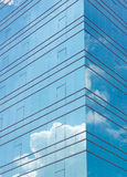 Clouds reflected in modern building stock image