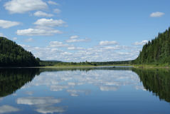 Clouds reflected in the river Royalty Free Stock Image
