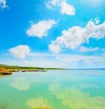Clouds reflected on the sea in Lazzaretto beach Stock Photo