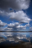 Clouds reflected in water Royalty Free Stock Image