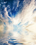 Clouds reflected in water stock photos