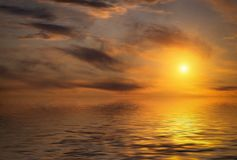 Clouds reflected in water. Dramatic sunset with clouds reflected in water Royalty Free Stock Images