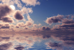 Clouds reflected in water. Stock Images