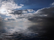 Clouds reflected in water. Stock Photos
