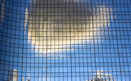 Clouds reflected in the windows Royalty Free Stock Images