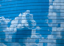 Clouds reflected in windows Stock Images