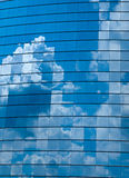 Clouds reflected in windows Stock Photography