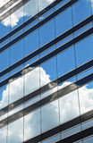 Clouds reflected in windows. Clouds reflected in  clear windows Stock Photo