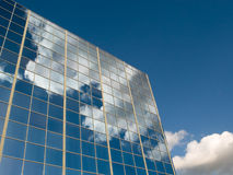 Clouds reflected in windows. Of modern office building Stock Images