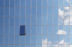 Clouds reflected in windows of modern building Stock Photography