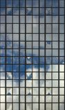 Clouds Reflected in Windows of Modern Office Building Royalty Free Stock Photos