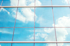 Clouds reflected in windows. Of modern office building royalty free stock photo