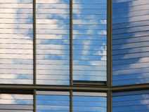 Clouds reflected in windows Royalty Free Stock Photo