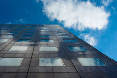 Clouds reflected in windows of modern office building Stock Photography