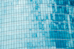 Clouds reflected in windows of modern office building. Royalty Free Stock Photography