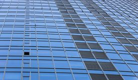 Clouds Reflected in Windows of Modern Office Building Royalty Free Stock Images