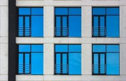 Clouds Reflected in Windows of Modern Office Building Stock Photo
