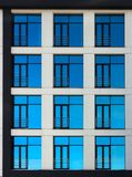 Clouds Reflected in Windows of Modern Office Building Royalty Free Stock Photo