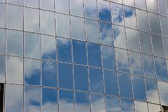 Clouds Reflected in Windows of Modern Office Building Stock Photos