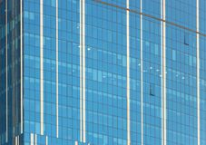 Clouds Reflected in Windows of Modern Office Building Stock Image
