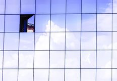Clouds reflected in windows of modern skyscraper office building. stock images