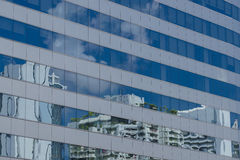 Clouds reflected in windows of office building. Clouds reflected in windows of modern office building Stock Photo