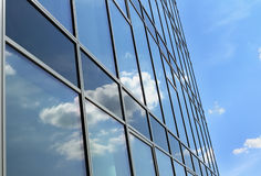 Clouds reflected in windows of office building Royalty Free Stock Images