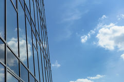 Clouds reflected in windows of office building Royalty Free Stock Photos