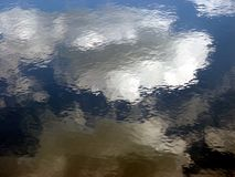 Clouds Reflecting. Reflection of clouds on water, nashawannuck pond, easthampton, massachusetts Stock Image