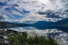 Clouds reflecting in alpine lake Royalty Free Stock Photography
