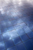 Clouds reflecting on blue windows Royalty Free Stock Photo