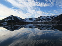 Clouds reflecting in calm waters, Svalbard, Norway Royalty Free Stock Photography
