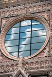 Clouds reflecting on church window in Italy Royalty Free Stock Image
