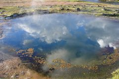 Clouds Reflecting in a Geyser Pool Stock Photography