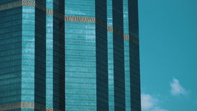 Clouds reflecting in the glass windows of a building. Clouds reflecting in the glass windows of a high building. Thailand. 4K Timelapse stock footage shot stock footage