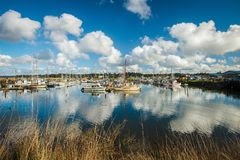 Reflecting clouds around boats in Oregon royalty free stock photo