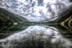 Clouds reflecting on lake surface