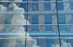 Clouds reflecting in modern office building. In the World Trade Center of Amsterdam Netherlands Royalty Free Stock Images