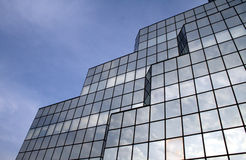 Clouds reflecting in windows #4. Part of Blue Tower in Warsaw Royalty Free Stock Image