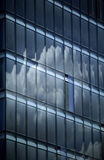 Clouds reflection. Reflection of clouds on a multi window facade stock photography