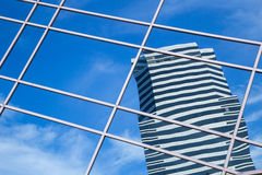 A clouds reflection in glass wall of skyscraper Royalty Free Stock Images
