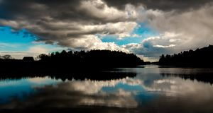 Clouds reflection in the water. Picure from Langø in Norway. The calm weather made the water Clear and the reflections amazing Royalty Free Stock Photography