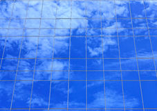 Clouds reflectionon on office building Stock Photos