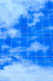 Clouds reflectionon on office building Stock Images